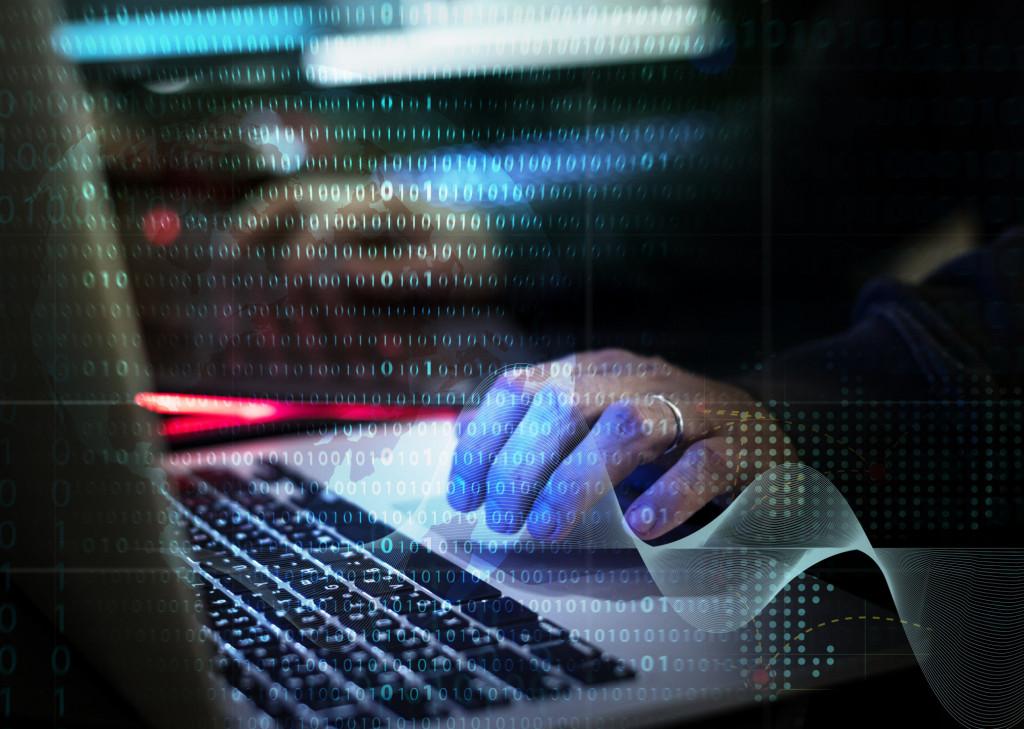 Binärsystem und Mann am Laptop